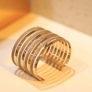 Jewelry - Gold and sparkling wrist cuff